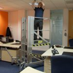Deskglider being used to access ceiling in office