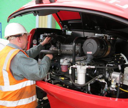 trained professional conducting maintenance work on an AFI Resale access platform machine